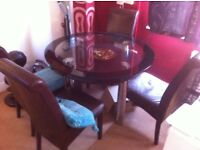 LARGE GLASS TABLE WITH 4 LEATHER CHAIR'S £50.00