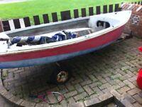 Sailing dingy or fish boat .