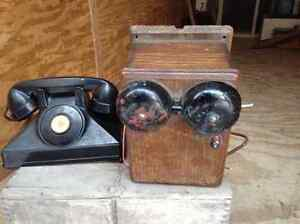 Antique telephone with two extra receivers
