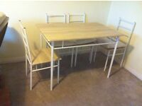 Brand new dining table n 4 chairs