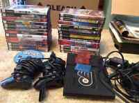 Playstation 2 console, 27 games and controllers
