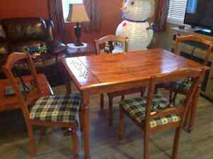 Dining room table and 4 chairs also coffee and end tables