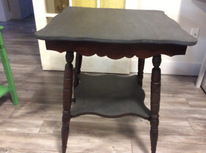 Antique table with glass claw feet.