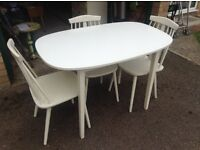 White table and three chairs