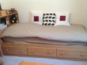 Twin storage bed and bookcase headboard for sale