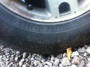 Ford escape alloy rims with 2 snow tires London Ontario image 2
