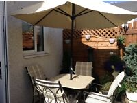 Marble top Garden table and four chairs with parasol