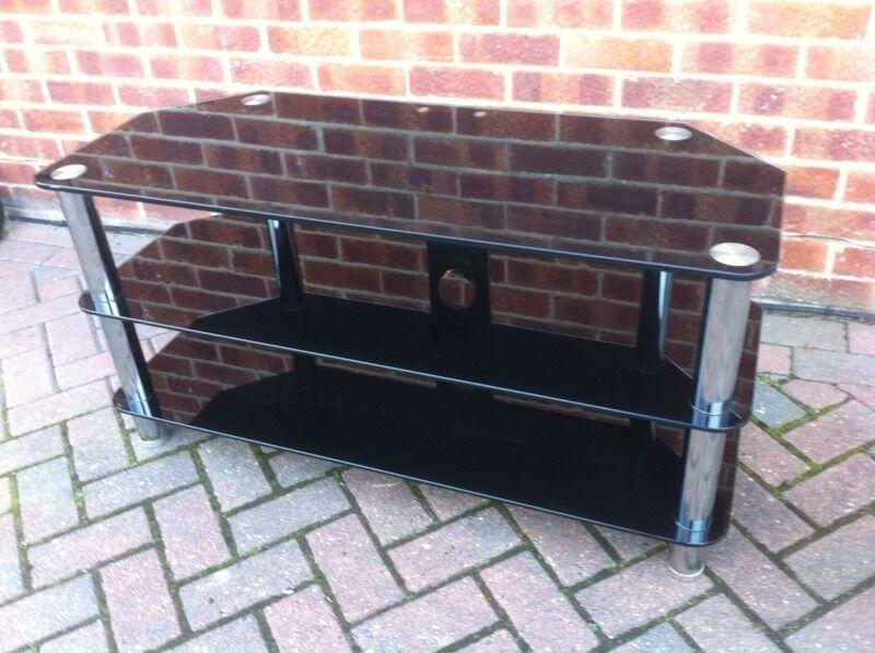 Large black and chrome glass TV unit.