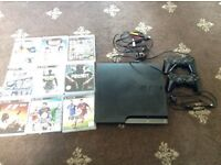 PS3 320gb with 2 controllers and 9 games