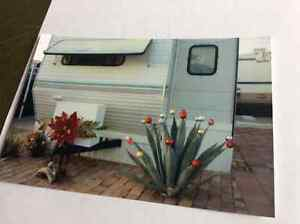 36' skylark nomad with slide out blocked and skirted.