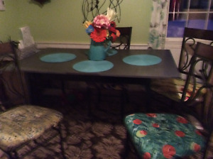 GOOD CONDITION Table and four chairs.