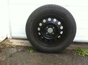 Goodyear Allegra tires mounted on steel rims