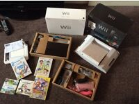 As new in box Nintendo wii with extras