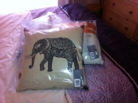 4 brand new cushions. MIX DESIGN