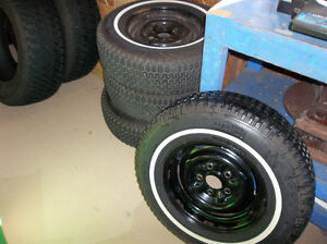Tires mounted on rims for sale.