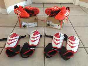 Kids adidas soccer shoes size 13 with shin pads