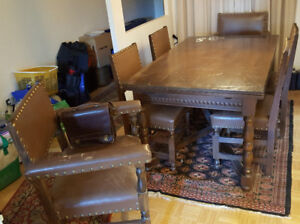 Dining Room Table + 8 leather upholstered chairs