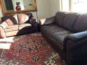 Dark brown leather love seat and sofa