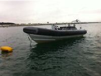 rib boat pacific 22 with a 140hp outboard twin axle trailer