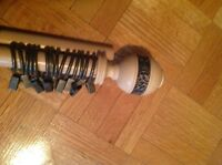 Wood curtain pole.