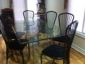 Full glass dining table with six chairs looks new