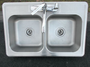 Stainless kitchen sink and focet
