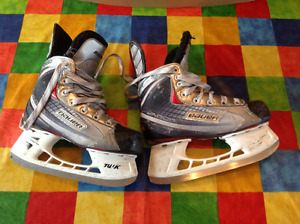 2 pairs of child size hockey skates for sale
