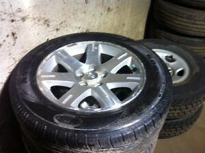 215/65R17 set of 4 all season on alloy rims came off 06 300