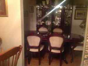 Beautiful formal  dining room table and China cabinet