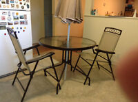 Glass top table, chairs & table umbrella