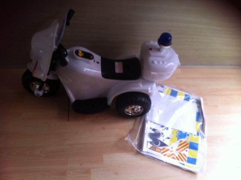 Boys police bike battery powered