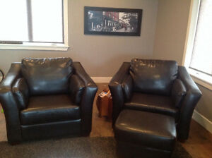 2 brown bonded leather chairs & ottoman