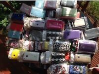 Over 200 iPhone cases and screen protectors.. NEW