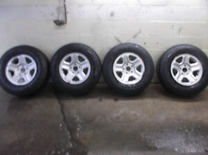 P225 75R16 Firestone Winter Force Tires Mounted On Rims