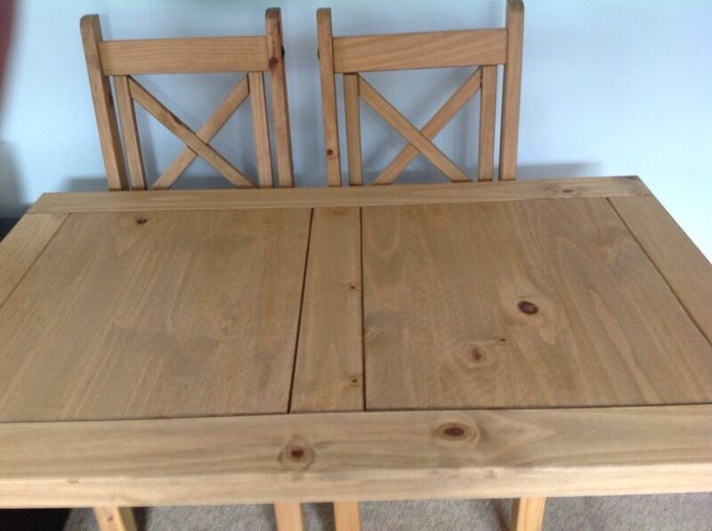 Pine Dining Table And Two Chairsin Poole, DorsetGumtree - Pine dining table in very good condition from non smoking home,120 cm long,75 cm wide,75cm tall.Legs taken off for transport.Also 2 pine chairs in generally good condition but small indentations in seat base,rest of chair is perfect.Collection only...