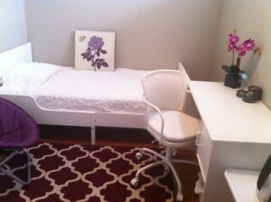 One room in a basement rent for short term for female.