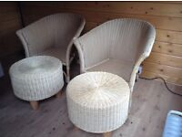 Two wicker chairs and stalls