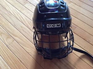 CCM junior helmet with face cage