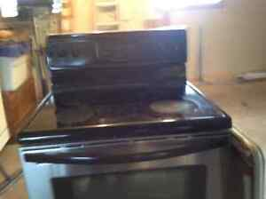 Frigidaire stainless steel black glass top stove self-cleaning