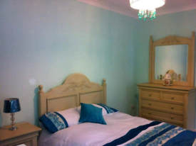 Bed, mirrored unit and side draws