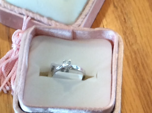 10K WHITE GOLD  .28.  SOLITAIRE DIAMOND RING. NOW $300.00