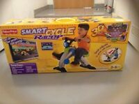 Fisher-Price Smart Cycle Physical Arcade Racer System BRAND NEW