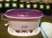 Dr. Scholl's Hand Waxing Machine.