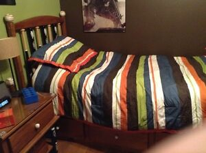 Solid pine twin mates bed with baseball bat spindles