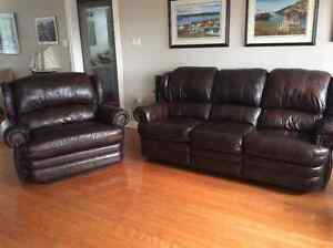 Brown leather chesterfield and 2 person cuddler.