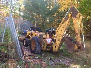John Deere JD300 loader backhoe.