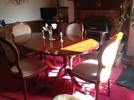 Reproduction double pedastal table and four chairs with insert leaf