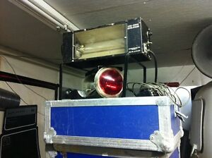 """2 Luma Power Strobes and 12"""" beacons in road cases."""