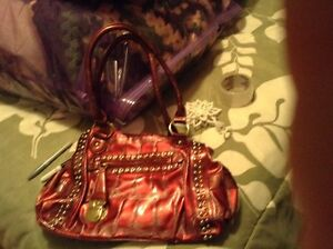 Red/pink purse with gold accents