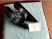 Black patent heels, size 5